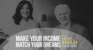 Bob Proctor and Sandy Gallagher in black and white photo with caption, Make your income match your dreams: The New Lead the Field Coaching.